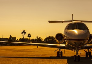 Beautiful jet is parked on an airfield during gorgeous golden sunset